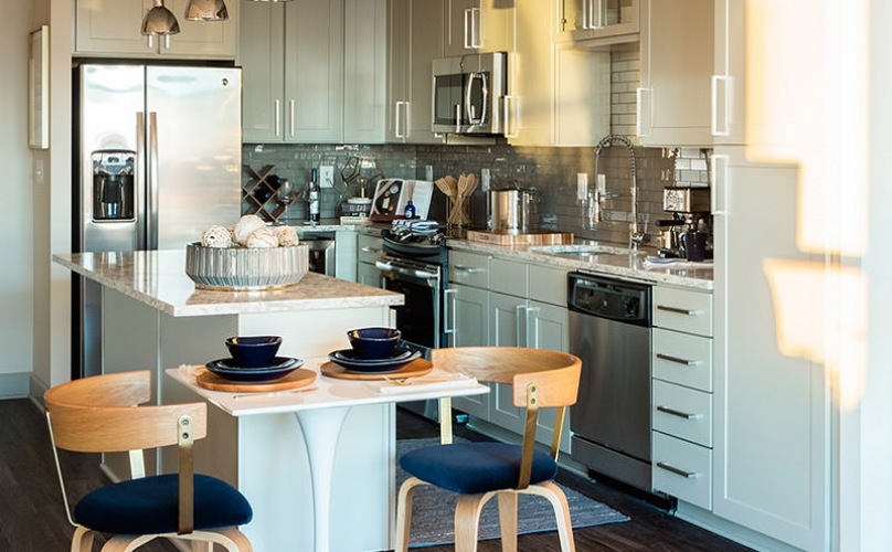kitchen showing island and stylish interior design amidst large open spacing