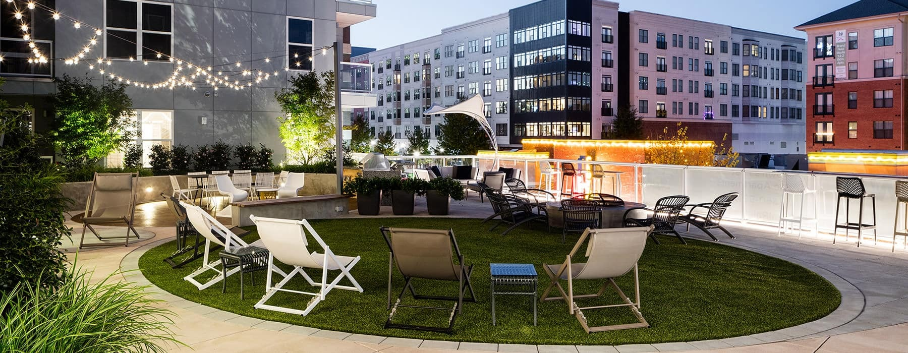 courtyard with turf lawns, seating arrangements, fire pits and open spaces