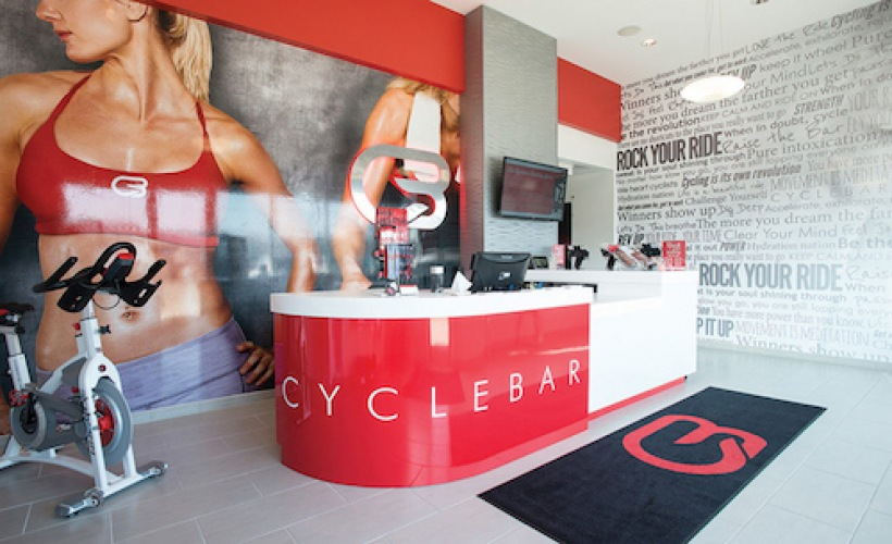front lobby showing check-in area and large graphics on the wall at CycleBar