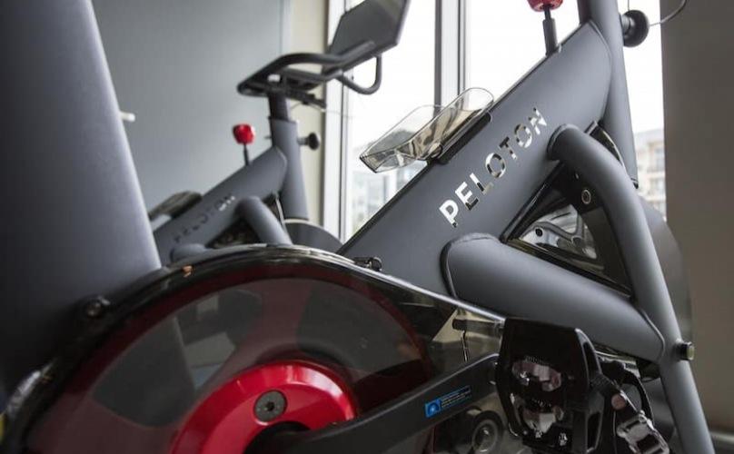 peloton bike in a bright-lit room