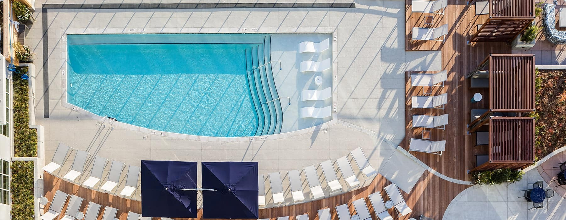 aerial view of property showing swimming pool and ample space for relaxing around the pool